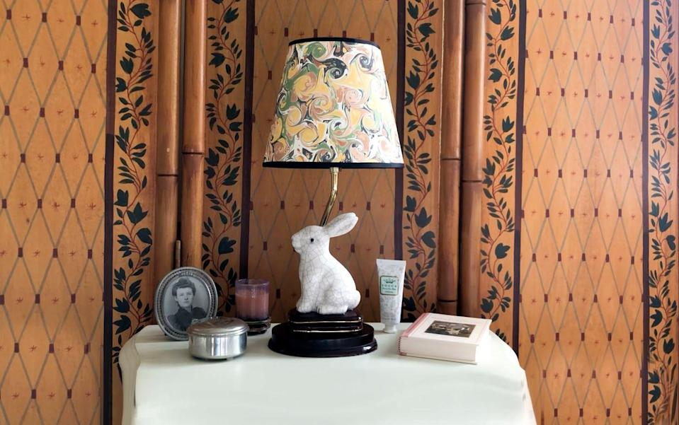 "<p>Bet you wouldn't have guessed that this expensive-looking shade was actually handmade with decorative paper found on Etsy. Yep, a bespoke lamp topper for just a few dollars. <a href=""https://www.housebeautiful.com/home-remodeling/diy-projects/a34032029/paper-lampshade-diy/"" rel=""nofollow noopener"" target=""_blank"" data-ylk=""slk:Here's how to make your own."" class=""link rapid-noclick-resp"">Here's how to make your own. </a></p>"