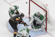 Dallas Stars goalie Ben Bishop (30) makes a save on Vegas Golden Knights' Reilly Smith (19) during the third period of an NHL hockey playoff game Monday, Aug. 3, 2020, in Edmonton, Alberta. (Jason Franson/The Canadian Press via AP)
