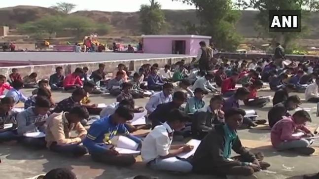 Students of classes ninth and eleventh were made to write exam on the school rooftop as their classrooms were used to lodge participants of a volleyball tournament.