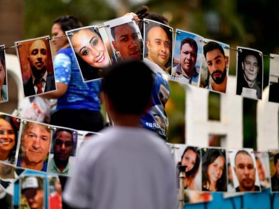 Portraits of the victims of the 25 January 2019 dam collapse on display during a tribute in Brumadinho (AFP via Getty Images)