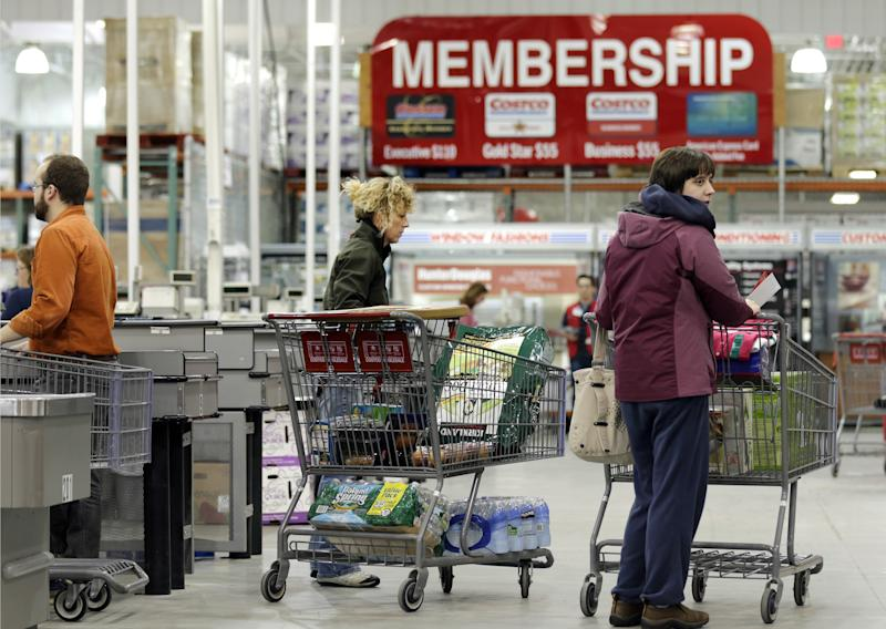 In this Tuesday, March 5, 2013, photo, shoppers push their carts at the Costco store in Nashua, N.H. Costco's fiscal second-quarter net income climbed 39 percent as it pulled in more money from membership fees, sales improved and it recorded a large tax benefit. The wholesale club operator earned $547 million, or $1.24 per share, for the period ended Feb. 17. That compares with $394 million, or 90 cents per share, a year earlier. (AP Photo/Charles Krupa)
