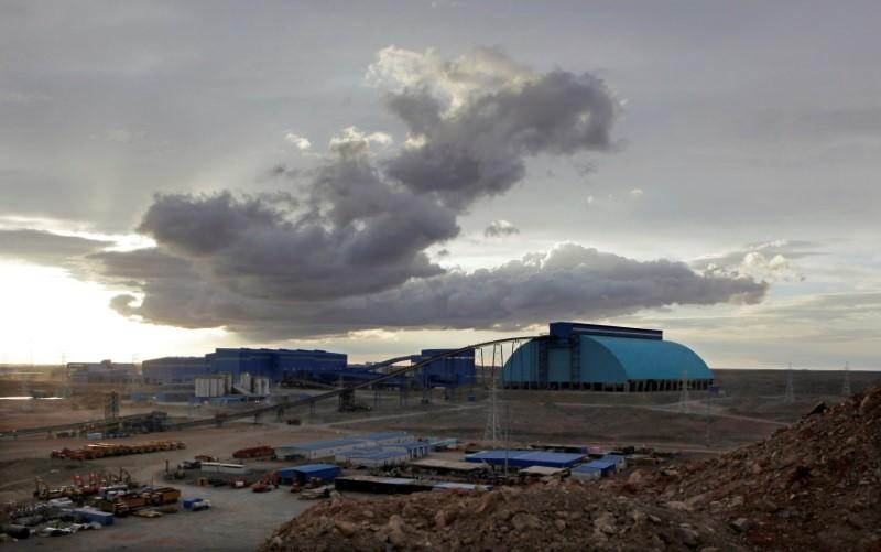 FILE PHOTO: Storm clouds are seen above the Oyu Tolgoi mine in Mongolia's South Gobi region