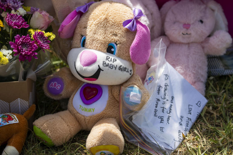 Tributes are seen at a house on Logan Reserve Road, Waterford West in Brisbane.