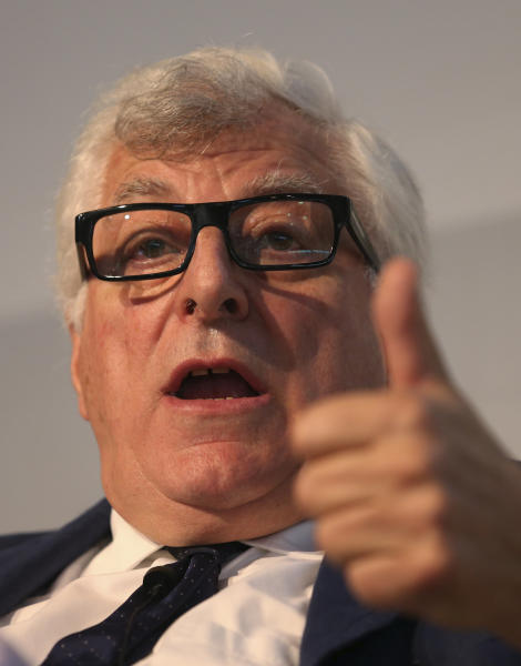 In this photo taken on June 13 2013, Prada fashion group CEO Patrizio Bertelli gestures as he attends a conference on fashion in Milan. Concern that Milan is losing prestige to London, Paris and New York is cracking the well-appointed composure of Milan's fashion world. The Italian National Fashion Chamber has been moved to action, announcing a reorganization this spring and making Prada's outspoken CEO Patrizio Bertelli the No. 2, with the goal of revitalizing Milan fashion. (AP Photo/Luca Bruno)