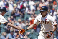 San Francisco Giants' LaMonte Wade Jr., right, is congratulated by third base coach Ron Wotus, left, as he rounds the bases after hitting a solo home run against the Los Angeles Angels during the fifth inning of a baseball game Monday, May 31, 2021, in San Francisco. (AP Photo/Tony Avelar)