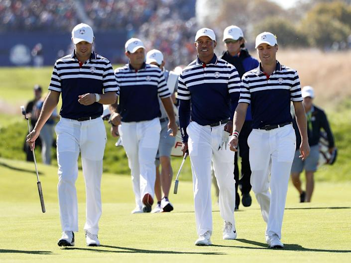 Members of the 2018 Ryder Cup team walk the course.