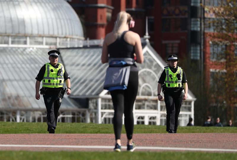 Police officers in Glasgow Green to ensure members of the public are following lockdown guidelines as the UK continues in lockdown to help curb the spread of the coronavirus. (Photo by Andrew Milligan/PA Images via Getty Images)