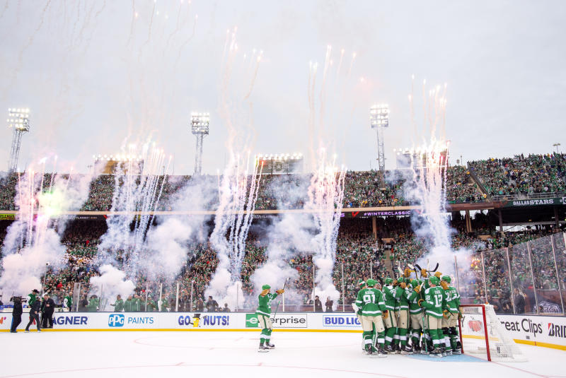 The Dallas Stars celebrate their 4-2 victory over the Nashville Predators at the end of the NHL Winter Classic hockey game at the Cotton Bowl, Wednesday, Jan. 1, 2020, in Dallas. (AP Photo/Jeffrey McWhorter)