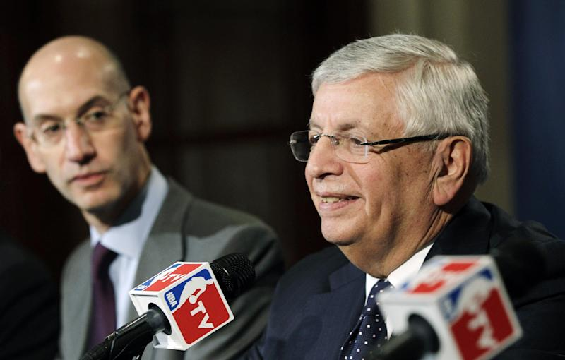 NBA Deputy Commissioner Adam Silver, left, listens as Commissioner David Stern speaks during a basketball news conference following Board of Governors meetings in New York, Thursday, Oct. 25, 2012. Stern announced he will retire on Feb. 1, 2014, 30 years after he took charge of the league. He will be replaced by Silver. (AP Photo/Kathy Willens)