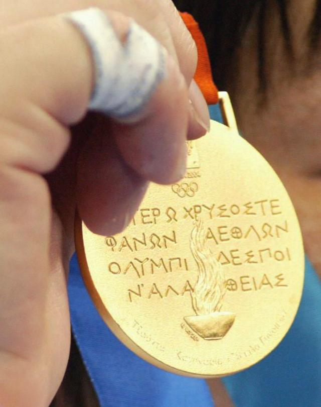 Close-up of the back of a gold medal from the 2004 Athens Olympic Games. (Photo by Vladimir Rys/Bongarts/Getty Images)