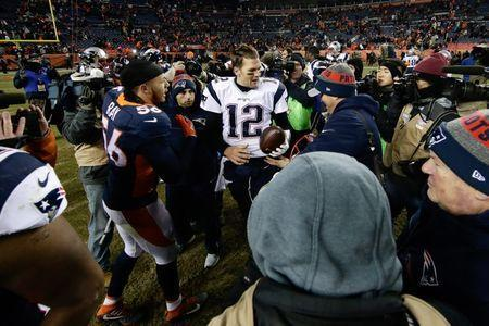FILE PHOTO: Dec 18, 2016; Denver, CO, USA; Denver Broncos outside linebacker Shane Ray (56) greets New England Patriots quarterback Tom Brady (12) after the game at Sports Authority Field at Mile High. The Patriots won 16-3. Mandatory Credit: Isaiah J. Downing-USA TODAY Sports - 9755632