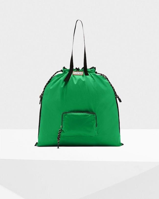 "Rain proof and packable! $45, Hunter. <a href=""https://www.hunterboots.com/us/en_us/bags/original-packable-tote/green/6014"">Get it now!</a>"