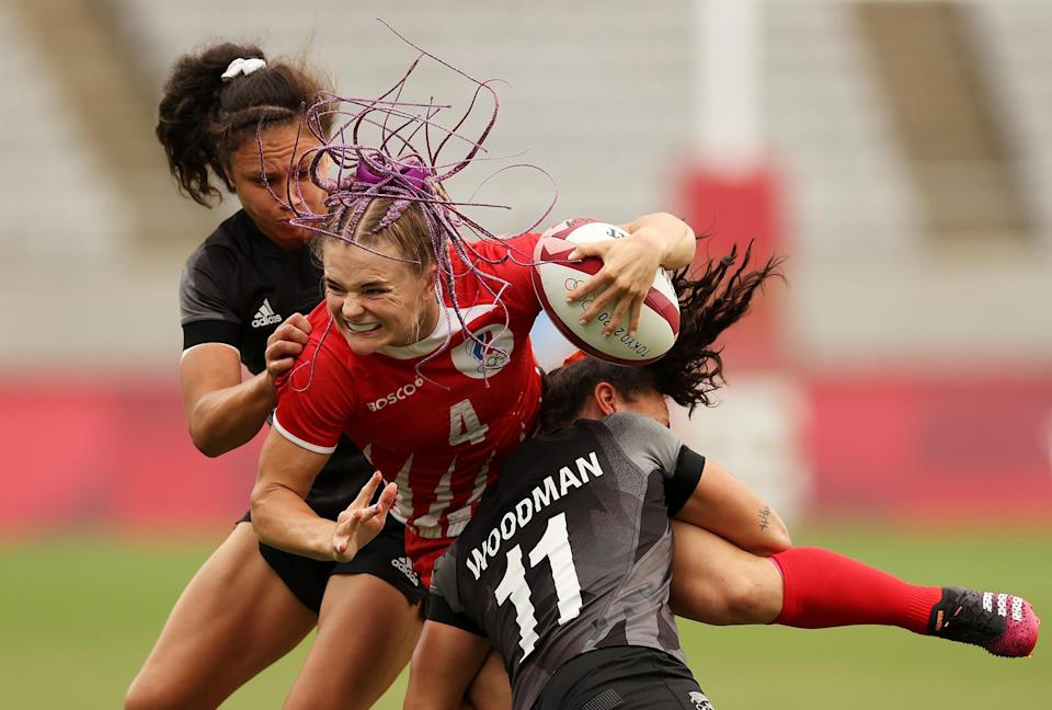 <p>Alena Tiron of the Russian Olympic Committee is tackled in the women's quarterfinal match against New Zealand on July 30.</p>