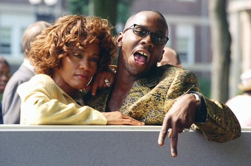UNITED STATES - JUNE 12: Whitney Houston is joined by her husband, singer Bobby Brown, at ceremonies in East Orange, N.J., where the Franklin School was renamed the Whitney E. Houston Academy of Creative and Performing Arts. (Photo by Richard Corkery/NY Daily News Archive via Getty Images)