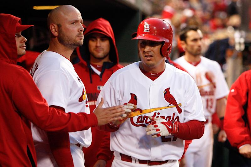 St. Louis Cardinals' Allen Craig is congratulated by teammates after scoring on a wild pitch during the fourth inning of a baseball game against the Atlanta Braves Friday, May 16, 2014, in St. Louis. (AP Photo/Scott Kane)