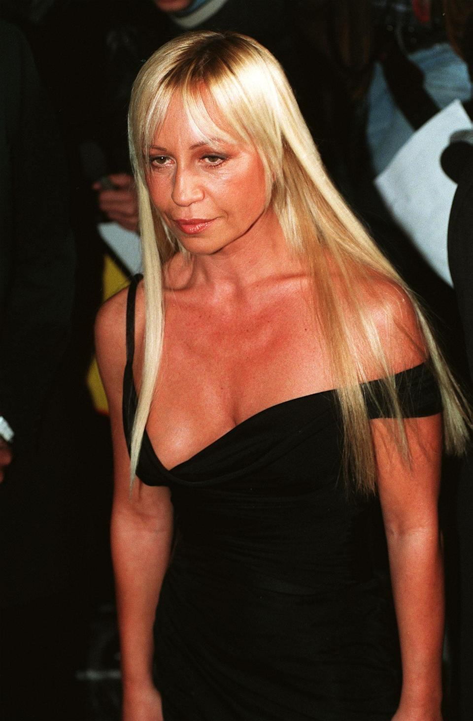 <p>Three months after Gianni was murdered, Donatella appears in public – still with her natural glow at the age of 42. <i>[Photo: PA]</i> </p>