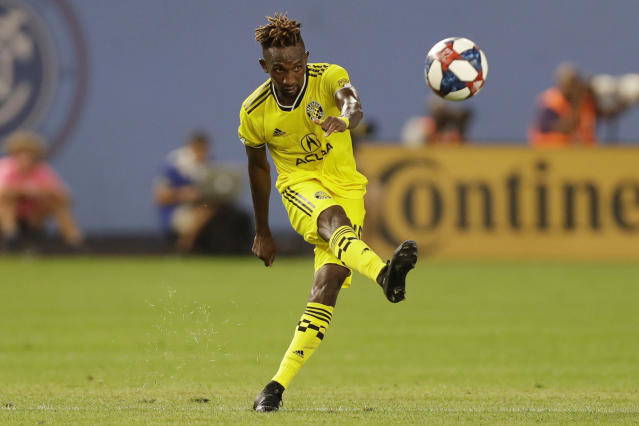 Columbus Crew defender Harrison Afful (25) kicks the ball down the field during the second half of an MLS soccer match, Wednesday, Aug. 21, 2019, in New York. New York City FC defeated Columbus 1-0. (AP Photo/Kathy Willens)
