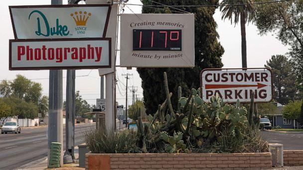 PHOTO: A sign displays a temperature of 117 degrees Fahrenheit on June 15, 2021 in Phoenix, Ariz.  (Caitlin O'Hara/Getty Images)