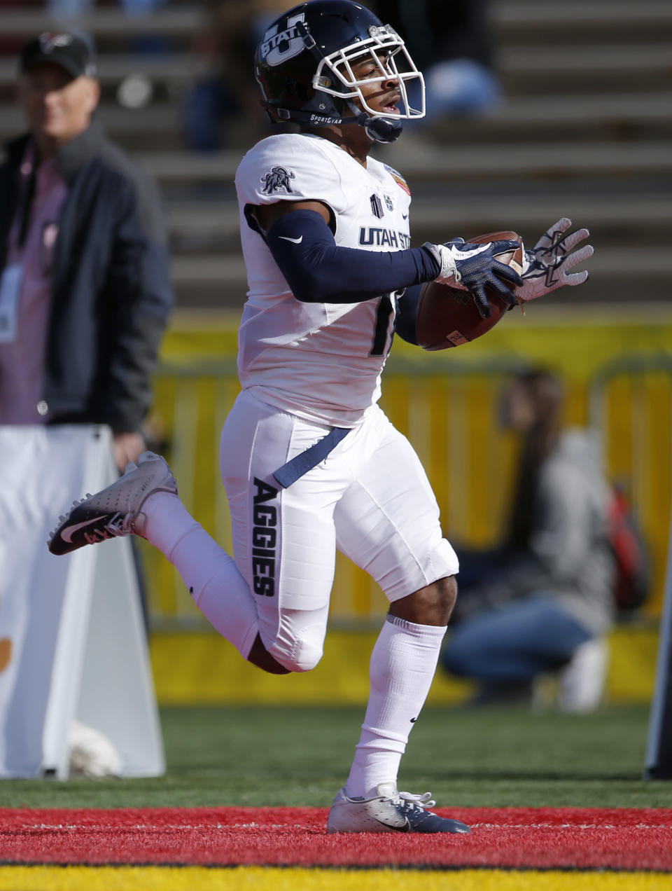 Utah State wide receiver Aaren Vaughns scores a touchdown against North Texas during the first half of the New Mexico Bowl NCAA college football game in Albuquerque, N.M., Saturday, Dec. 15, 2018. (AP Photo/Andres Leighton)