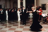 """<p>The actor dressed for the White House state dinner in 1985 in a sharp tuxedo, and <a href=""""https://www.townandcountrymag.com/society/tradition/a30195954/princess-diana-john-travolta-dancing-dress-sold-kensington-palace/"""" rel=""""nofollow noopener"""" target=""""_blank"""" data-ylk=""""slk:honored the Princess with a dance"""" class=""""link rapid-noclick-resp"""">honored the Princess with a dance</a>, too.</p>"""
