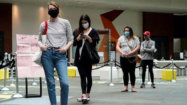 PHOTO: In this June 2, 2020, file photo, people wearing masks to prevent the spread of COVID-19 wait to vote in the primary election in Philadelphia. (Joshua Roberts/Reuters, FILE)