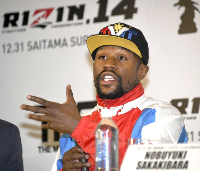 Floyd Mayweather of the U.S. speaks during a press conference in Tokyo, Monday, Nov. 5, 2018. Mayweather said he has signed to fight Japanese kickboxer Tenshin Nasukawa for a bout promoted by Japan's RIZIN Fighting Federation on Dec. 31 in Saitama, north of Tokyo. (Katsuya Miyagawa/Kyodo News via AP)