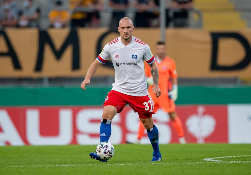 Toni Leistner of Hamburger SV in action during the DFB Cup first round match between Dynamo Dresden and Hamburger SV.