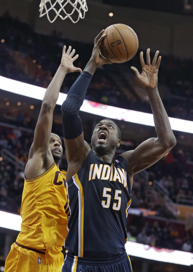 Indiana Pacers' Roy Hibbert (55) shoots against Cleveland Cavaliers' C.J. Miles during the fourth quarter of an NBA basketball game Sunday, Jan. 5, 2014, in Cleveland. The Pacers won 82-78. (AP Photo/Tony Dejak)