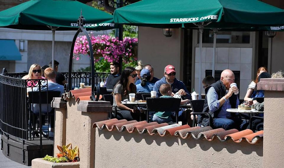 Customers at Starbucks on the Country Club Plaza could shed their masks as Mayor Quinton Lucas announced Friday the city is fully lifting its COVID-19 emergency order.