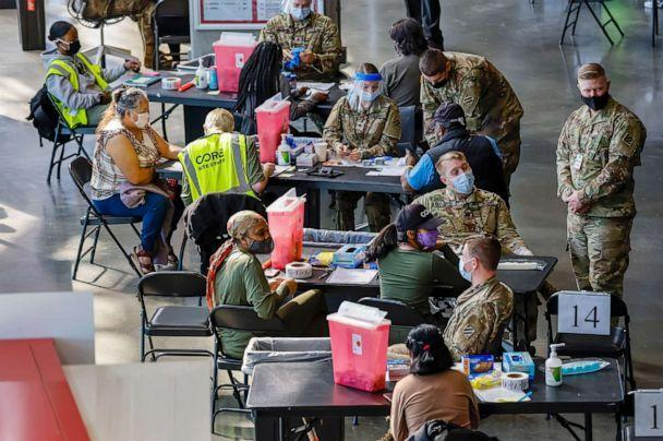 PHOTO: U.S. Army medics administer shots at the Mercedes-Benz Stadium Community Vaccination Center, a jointly run COVID-19 mass vaccination site, in Atlanta, March 29, 2021. (Erik S. Lesser/EPA via Shutterstock, FILE)