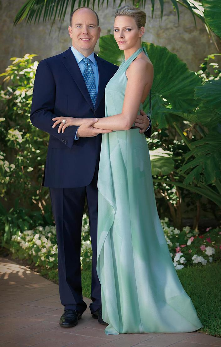 <p>For her royal engagement announcement, Charlene stood in the palace garden showing off her Repossi engagement ring in a backless pale green halter dress from Swiss designer Akris.</p>