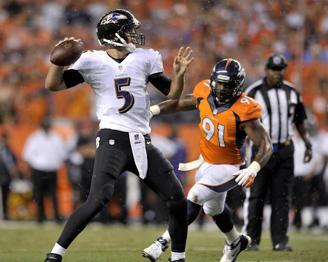 Baltimore Ravens quarterback Joe Flacco (5) throws as Denver Broncos defensive end Robert Ayers (91) pursues during the first half of an NFL football game, Thursday, Sept. 5, 2013, in Denver. (AP Photo/Jack Dempsey)