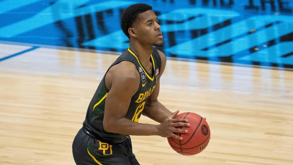 April 5, 2021; Indianapolis, IN, USA; Baylor Bears guard Jared Butler (12) in the second half during the national championship game in the Final Four of the 2021 NCAA Tournament against the Gonzaga Bulldogs at Lucas Oil Stadium. Mandatory Credit: Kyle Terada-USA TODAY Sports ORG XMIT: IMAGN-446986 ORIG FILE ID:  20210409_kkt_st3_152.jpg