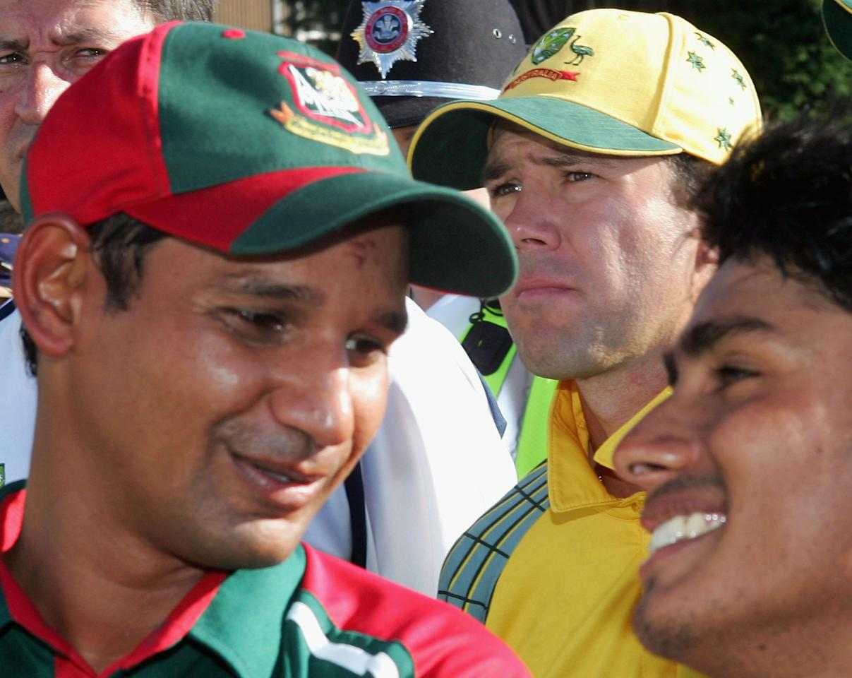 Ricky Ponting (centre) of Australia reflects on his team's loss as Habibul Bashar (left) and Mohammad Ashraful of Bangladesh enjoy their win after the NatWest Series One Day International between Australia and Bangladesh played at Sophia Gardens on June 18, 2005 in Cardiff, United Kingdom  (Photo by Hamish Blair/Getty Images)