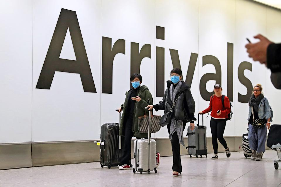 Passengers in the arrivals concourse at Heathrow Terminal 4, London, as the Government's Cobra committee is meeting in Downing Street to discuss the threat to the UK from coronavirus.
