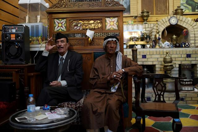 Residents sit in a popular cafe at al-Mutanabi Street in Baghdad, Iraq June 22,2018. REUTERS/Thaier al-Sudani TPX IMAGES OF THE DAY