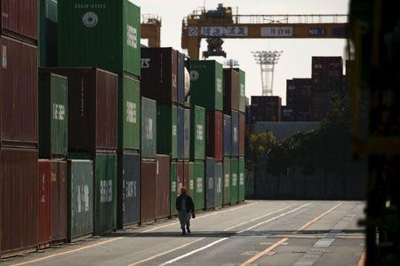 Japan November exports beat expectations as yen tumbles, volumes rise