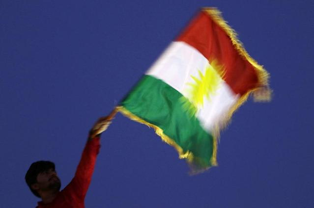 <p>A man waves a Kurdish flag during an event to urge people to vote in the upcoming independence referendum in Arbil, the capital of the autonomous Kurdish region of northern Iraq. (Photo: Safin Hamed/AFP/Getty Images) </p>