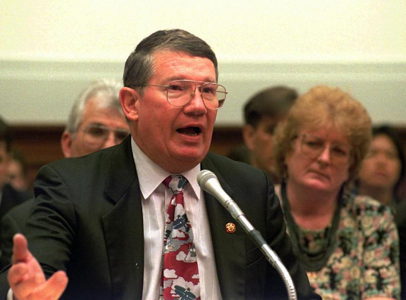 "FILE - Rep. Randy ""Duke"" Cunningham R-Calif, gestures while testifying on Capitol Hill in this July 12, 1995 file photo. Cunningham, whose feats as a Navy flying ace during the Vietnam War catapulted him to a U.S House career that ended in disgrace when he was convicted of accepting $2.4 million in bribes from defense contractors, is completing one of the longest prison sentence ever given to a member of Congress. Cunningham, 71, is due to be released Tuesday June 4, 2013.  (AP photo/Dennis Cook, File)"