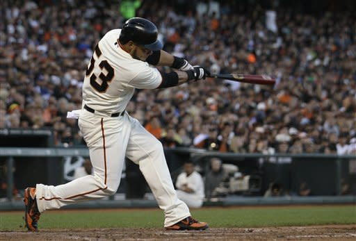 San Francisco Giants' Melky Cabrera hits a solo home run off of Los Angeles Dodgers pitcher Clayton Kershaw during the fourth inning of a baseball game in San Francisco, Tuesday, June 26, 2012. (AP Photo/Jeff Chiu)