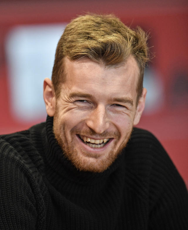 Leverkusen's goalkeeper Lukas Hradecky laughs during an interview with the Associated Press at the BayArena in Leverkusen, Germany, Monday, Dec. 2, 2019. Bayer Leverkusen keeper Lukas Hradecky dislodged a contact lens while playing against the German champions Bayern on Saturday, but he still helped Leverkusen to a surprise win. (AP Photo/Martin Meissner)
