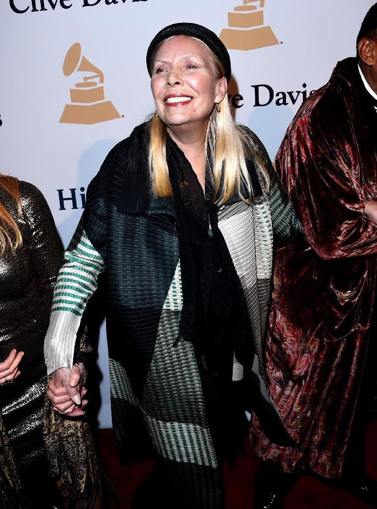 Joni Mitchell is known for her distinctively rich contralto voice and open-tuned guitar