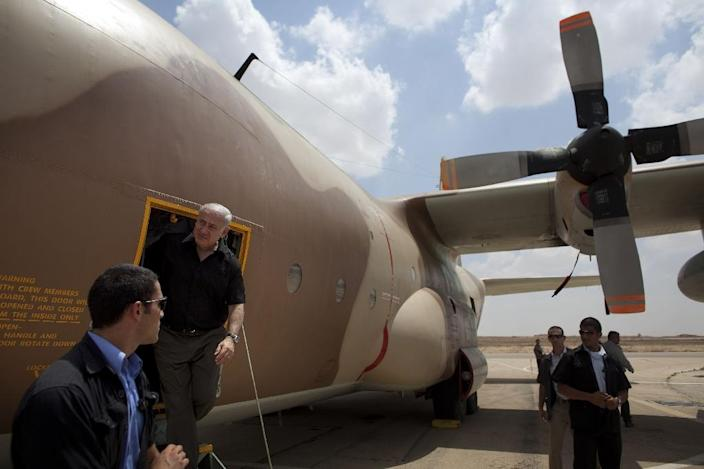 Israeli Prime Minister Benjamin Netanyahu walks out of a C-130 Hercules aircraft which was used in the 1976 raid on Entebbe airport in Uganda, during a visit to the Hatzerim air base in southern Israel, in 2009 (AFP Photo/Uriel Sinai)