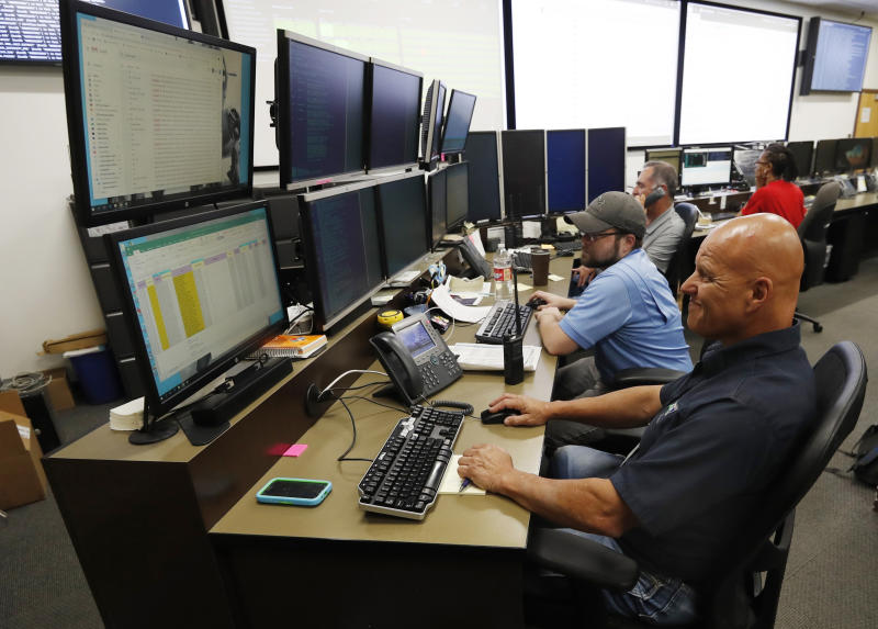 "In this Sept. 12, 2019, photo, monitors check their screens in the Governor's Office of Information Technology in Denver. Some cybersecurity professionals are concerned that insurance policies designed to limit the damage of ransomware attacks might actually be encouraging hackers. ""We don't know what that ransom payment is going to fund,"" said Brandi Simmons, a spokeswoman for the office. ""As a state government, we don't want to be in a position of funding cyberterrorists."" (AP Photo/David Zalubowski)"