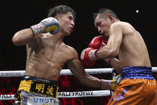 Japan's Naoya Inoue, left, sends a left to Philippines' Nonito Donaire in the 10th round of their World Boxing Super Series bantamweight final match in Saitama, Japan, Thursday, Nov. 7, 2019. Inoue beat Donaire with a unanimous decision to win the championship. (AP Photo/Toru Takahashi)