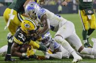 Green Bay Packers' Aaron Jones runs for a touchdown during the second half of an NFL football game against the Detroit Lions Monday, Sept. 20, 2021, in Green Bay, Wis. (AP Photo/Mike Roemer)