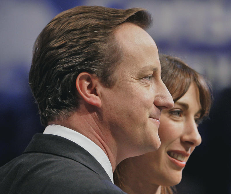 FILE This Wednesday, Oct. 3, 2007 file photo shows David Cameron, leader of Britain's opposition Conservative Party  with his wife Samantha, after he delivering his keynote speech on the last day of the annual Conservative Party conference in Blackpool, England. British Prime Minister David Cameron's office confirmed Monday June 11, 2012 that the prime minister accidentally left his 8-year-old daughter Nancy in a pub after a family Sunday lunch near his country home, west of London. They said the incident happened a few months ago as the family was leaving the pub. Cameron was travelling in one car with his bodyguards and assumed that Nancy was in the other car with his wife Samantha and two other children. Samantha assumed the child was with her father and only realized she was missing when they got home.(AP Photo/Kirsty Wigglesworth, File)