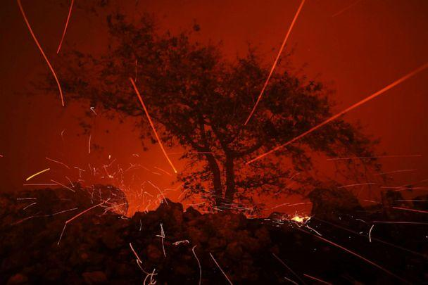 PHOTO: Embers blow in the wind as the Kincaide Fire burns through the area on October 24, 2019 in Geyserville, California. (Justin Sullivan/Getty Images)