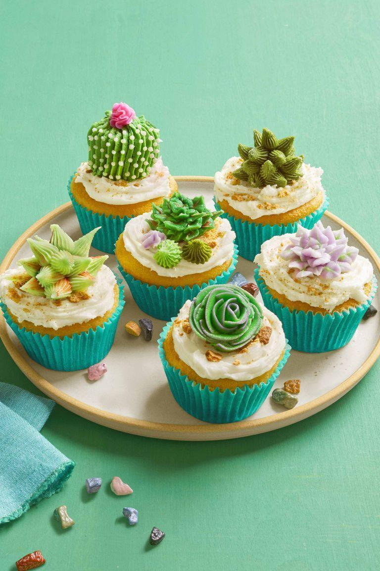 """<p>You can nail the icing's texture with different icing tips to create the garden you wish you had this summer.</p><p><em><strong><a href=""""https://www.womansday.com/food-recipes/food-drinks/a26356939/desert-bloom-cupcakes-recipe/"""" rel=""""nofollow noopener"""" target=""""_blank"""" data-ylk=""""slk:Get the Desert Bloom Cupcakes recipe."""" class=""""link rapid-noclick-resp"""">Get the Desert Bloom Cupcakes recipe.</a></strong></em></p>"""