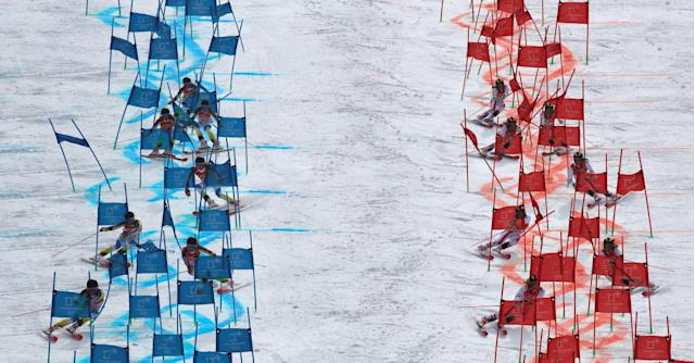 Alpine Skiing - Pyeongchang 2018 Winter Olympics - Team Event Quarterfinal - Yongpyong Alpine Centre - Pyeongchang, South Korea - February 24, 2018 - Frida Hansdotter of Sweden (L) and Katharina Liensberger of Austria compete. Picture taken with multiple exposure. REUTERS/Stefano Rellandini TPX IMAGES OF THE DAY